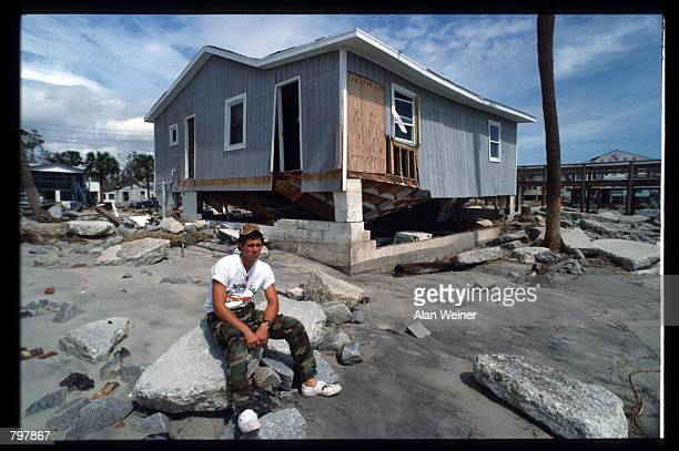 A man sits in front of a damaged building September 27 1989 in South Carolina Hugo is ranked as the eleventh most intense hurricane to strike the US...