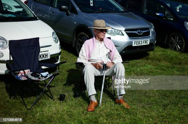 A man sits in front of his car watching the show during 152nd the Ryedale Country Show on July 31 2018 in Kirbymoorside England Held in Welburn Park...