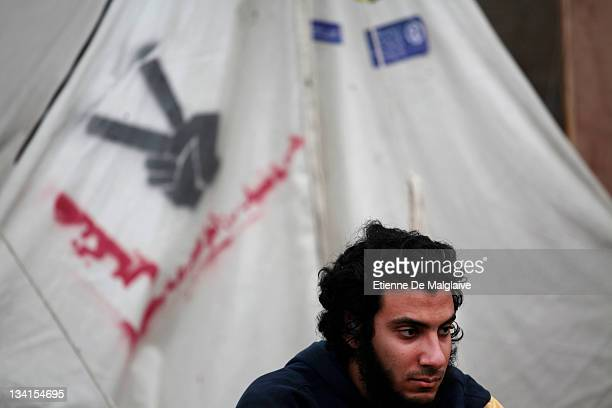 A man sits in Tahrir Square on November 27 2011 in Cairo Egypt Thousands of Egyptians are continuing to occupy Tahrir Square ahead of parliamentary...