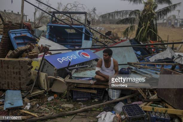 A man sits in the debris of his roadside store after Cyclone Fani passes in the Puri district of Odisha India on Saturday May 4 2019 A category 4...