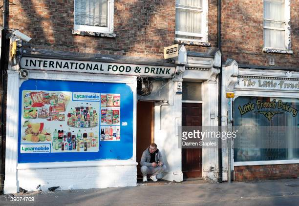 A man sits in the doorway of an International grocery shop on March 29 2019 in Boston England The town of Boston in Lincolnshire voted with a 75%...