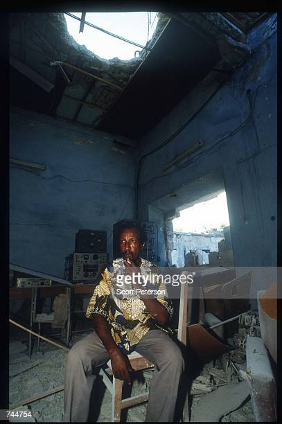 A man sits in the rubble of Radio Mogadishu December 6 1993 in Mogadishu Somalia US gunships attacked the compound of warlord Mohammad Aidid in...