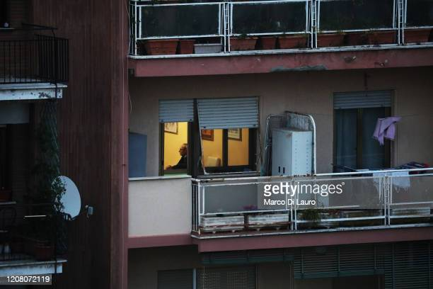 A man sits inside his apartment on March 22 2020 in Rome Italy As Italy extends its nationwide lockdown to control the spread of COVID19 its citizens...
