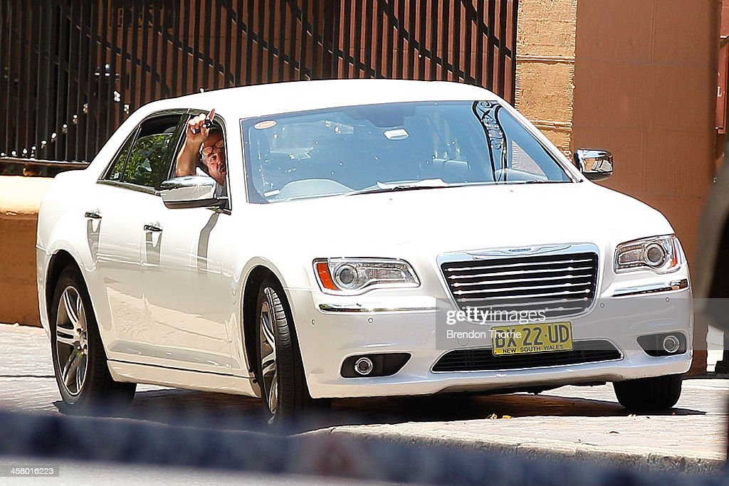 A man sits inside his vehicle outside NSW Parliament House on Macquarie Street on December 20, 2013 in Sydney, Australia. The NSW Parliament House was locked down due to a security threat outside the building. A man has been apprehended after a stand off with riot police.