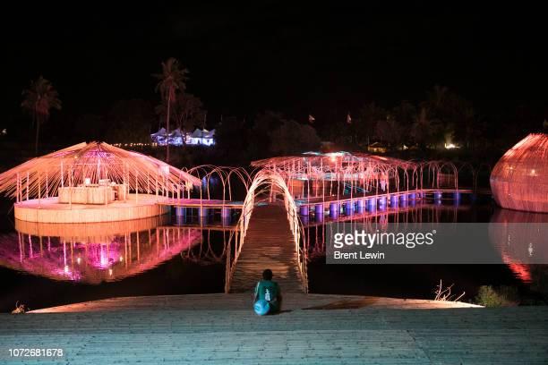 A man sits near an illuminated installation during Wonderfruit 2018 on December 13 2018 in Pattaya Thailand