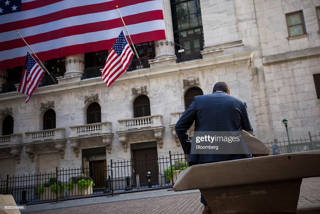 A man sits on a bench in front of the New York Stock Exchange (NYSE) in New York, U.S., on Monday, Sept. 12, 2016. U.S. stocks rebounded after the biggest rout since June wiped about $500 billion from the value of equities, while Treasury yields held near two-month highs before the Federal Reserve's Lael Brainard official speaks. Emerging-market assets slumped. Photographer: Michael Nagle/Bloomberg via Getty Images
