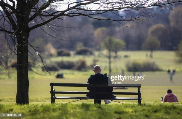 Man sits on a bench in Regents Park on April 04, 2020 in London, England. The Coronavirus pandemic has spread to many countries across the world,...