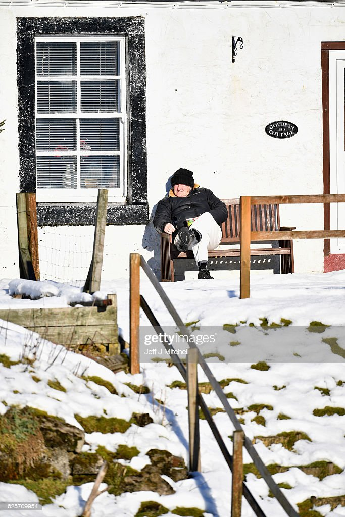 A man sits on a bench in the sun in Scotlands highest village on November 25, 2016 in Wanlockhead, Scotland. Widespread hard frost and patchy fog continues across many parts of Scotland and Northern Ireland.