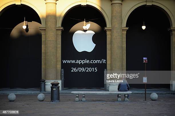 A man sits on a bench infront of the apple store on September 11 2015 in Florence Italy Apple announced its second store in Florence by unveiling a...