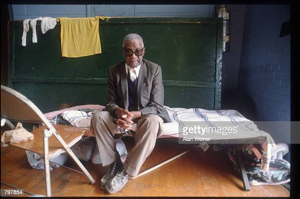 A man sits on a cot in a shelter September 27 1989 in South Carolina Hugo is ranked as the eleventh most intense hurricane to strike the US this...