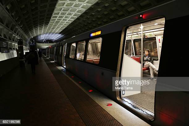 A man sits on a mostly empty Metro train in the McPherson Square Metro station before the swearingin ceremony on January 20 2017 in Washington DC...