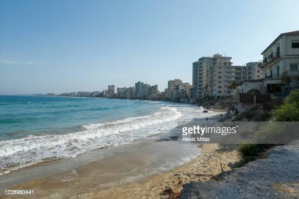 Man sits on a newly opened beach on October 9, 2020 in the disputed costal town of Varosha in Famagusta, Cyprus. The controversial reopening of the...