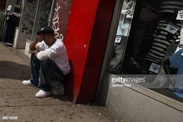 A man sits on a street corner on April 17 2009 in Newark New Jersey Newark New Jersey's largest city is struggling to hold onto economic gains made...