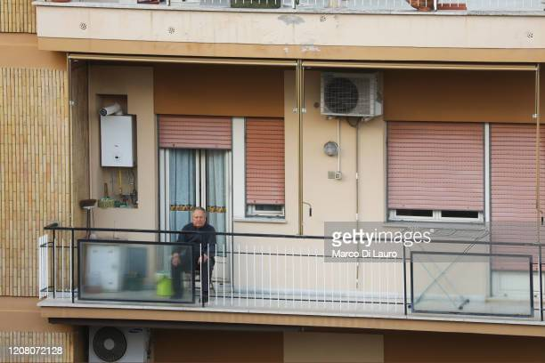 A man sits on his balcony on March 22 2020 in Rome Italy As Italy extends its nationwide lockdown to control the spread of COVID19 its citizens are...