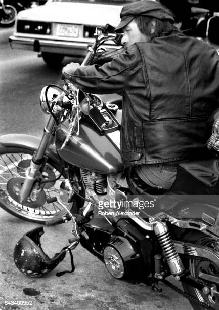 A man sits on his customized motorcycle in Daytona Beach Florida during the city's 1983 Bike Week The annual motorcycle event and rally has attracted...