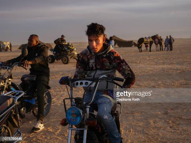 A man sits on his motorcycle after the end of the traditional performances at the Sahara Festival on December 20 2018 in Douz Tunisia The Sahara...