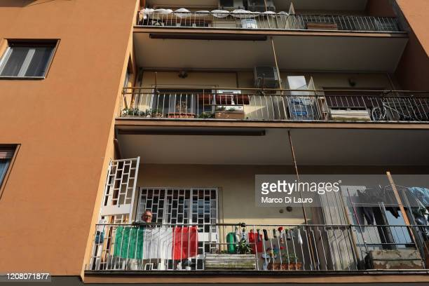 A man sits on the balcony of his apartment on March 22 2020 in Rome Italy As Italy extends its nationwide lockdown to control the spread of COVID19...