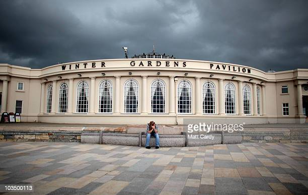 A man sits on the seafront close to the rebuilt Weston Grand Pier on August 20 2010 in WestonsuperMare England The new 51million GBP Grand Pier which...