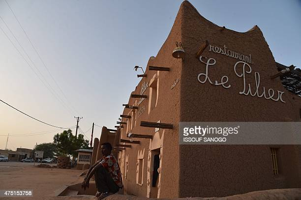 A man sits outside a restaurant in the central Niger city of Agadez on May 29 2015 AFP PHOTO / ISSOUF SANOGO