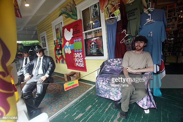 A man sits outside a souvenir shop as the 40th anniversary of the Woodstock music festival approaches August 13 2009 in Woodstock New York On August...