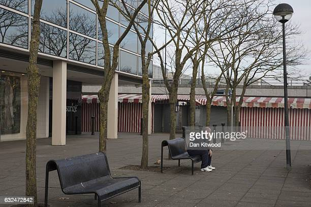 A man sits outside the 'Intu' Shopping Centre on January 23 2017 in Milton Keynes England Milton Keynes in Buckinghamshire marks the 50th anniversary...