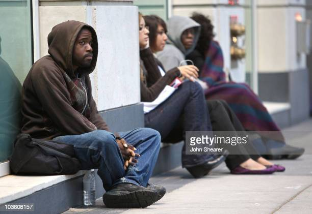 Man sits outside the Michael Jackson public memorial service held at Staples Center on July 7, 2009 in Los Angeles, California. Jackson the iconic...