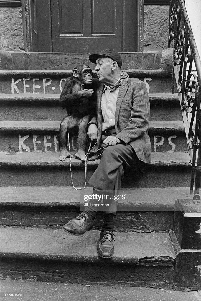 A man sits with a pet chimpanzee on steps in MacDougal Street, Greenwich Village, New York City, 1972.