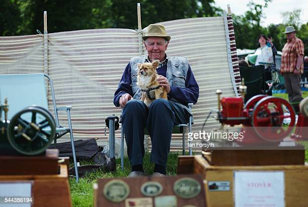 A man sits with his display of miniature engines at a display during the annual Duncombe Park Steam Fair on July 3 2016 in Helmsley England Held in...