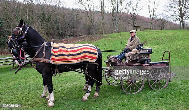 Man sits with his horse and trap as horses, riders and hounds from the Cleveland Hunt prepare to ride out on the traditional New Year's Day hunt on...