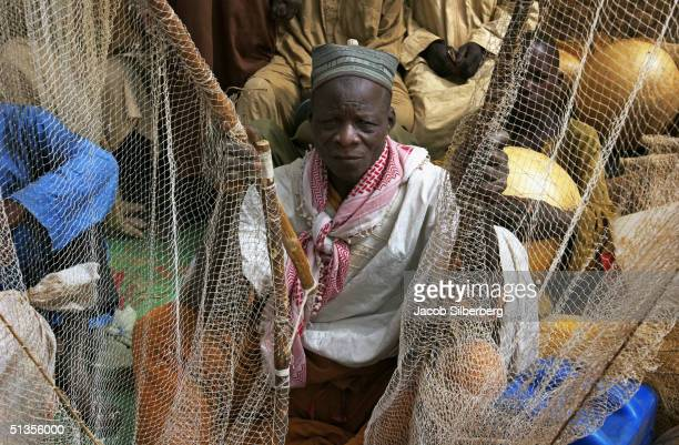 A man sits with his nets during the Argungu Fishing Festival on March 19 2004 in Argungu Nigeria The Argungu Fishing Festival was first held in 1934...