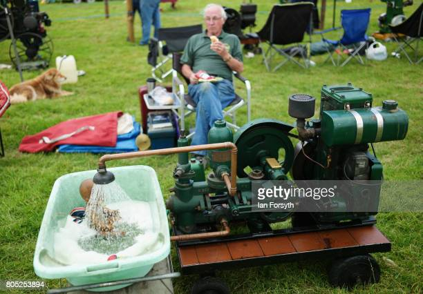 A man sits with his static engine display during the Duncombe Park Steam Rally on July 1 2017 in Helmsley United Kingdom Held annually in the...