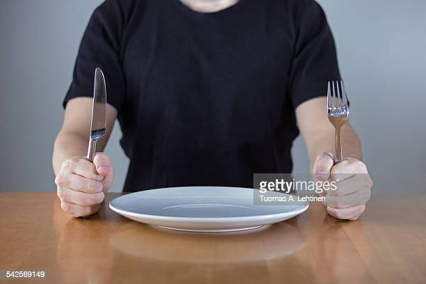 Man sitting at a table waiting for food