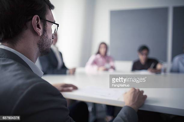 Man sitting at business meeting office table