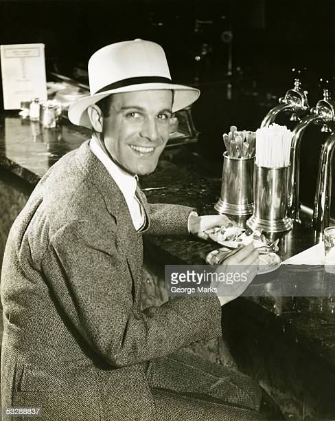 Man sitting at counter eating ice cream