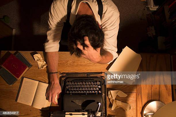 man sitting at desk with writers block - the_writer's_block stock pictures, royalty-free photos & images