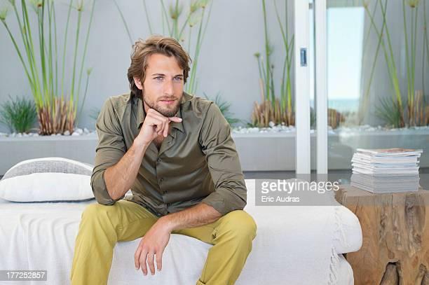 Man sitting at home and thinking