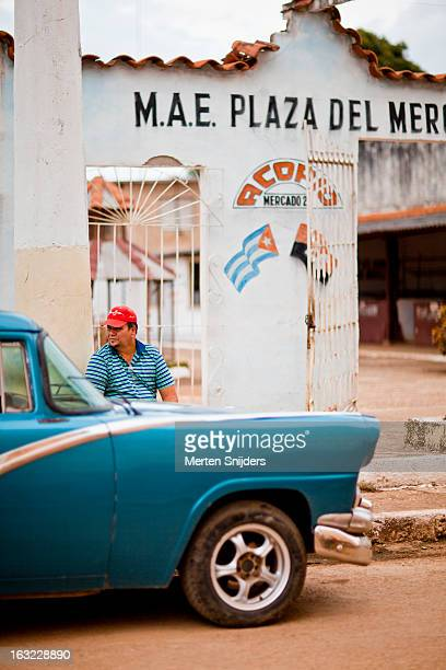 man sitting at market on andres del rio - merten snijders stock pictures, royalty-free photos & images