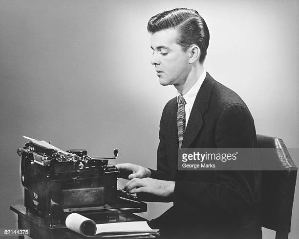 man sitting at typewriter, (b&w) - hair parting stock photos and pictures