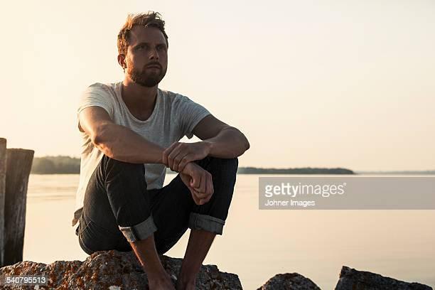 Man sitting at water