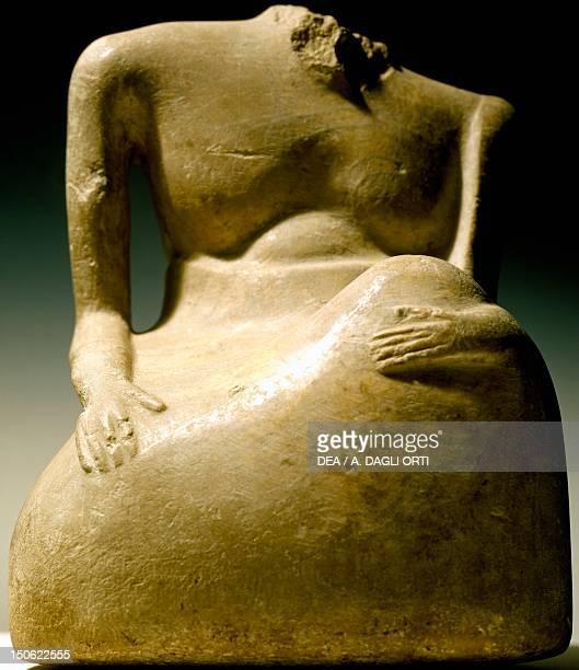 Man sitting head broken at beard alabaster statue from Mohenjodaro Pakistan Indus Valley Civilisation