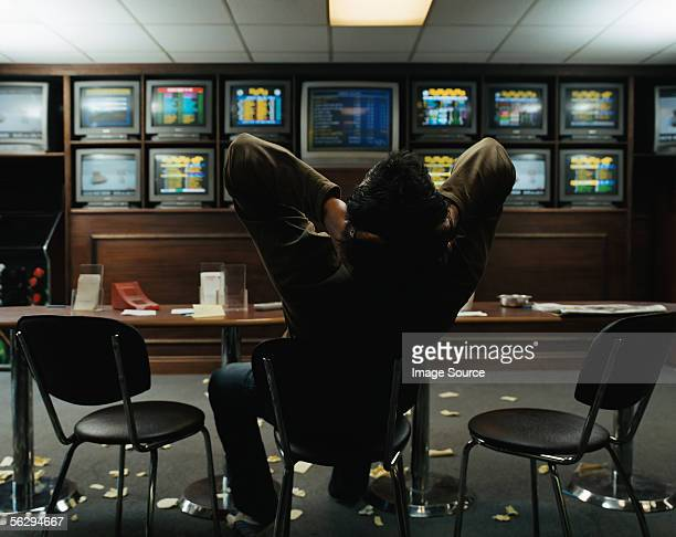 Man sitting in a betting shop