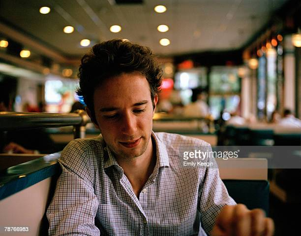 A man sitting in a diner