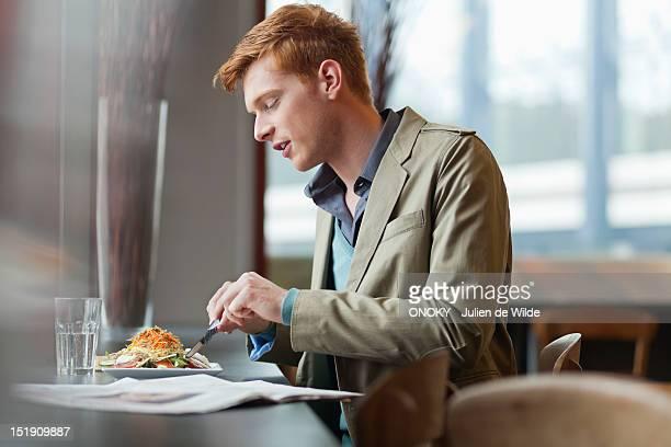 Man sitting in a restaurant taking lunch