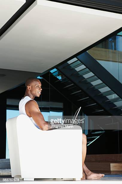 man sitting in armchair - hitech mod a stock pictures, royalty-free photos & images
