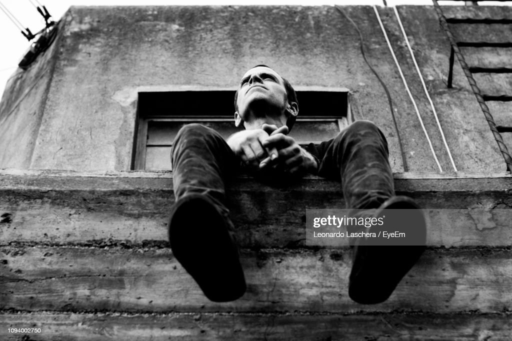 Man Sitting In Balcony Of Abandoned Building High Res Stock Photo Getty Images