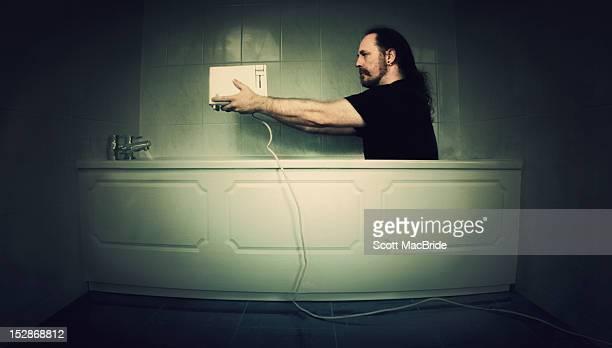 Man sitting in bath