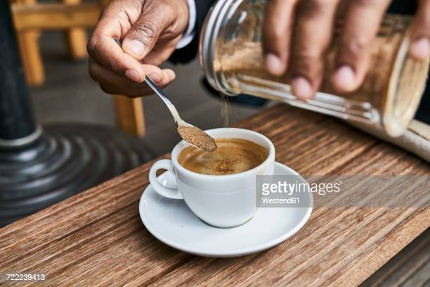 man sitting in cafe, drinking coffee - sugar coffee stock photos and pictures