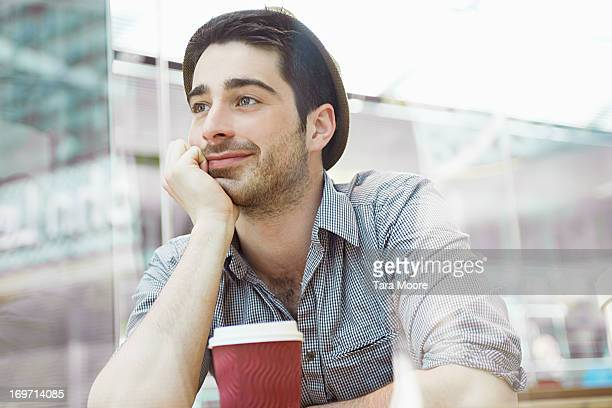 man sitting in cafe with coffee