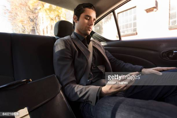 Man sitting in car