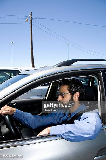 Man sitting in car, side view